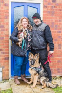 Emily and Allen Portwood standing outside their Warrington home with their dogs